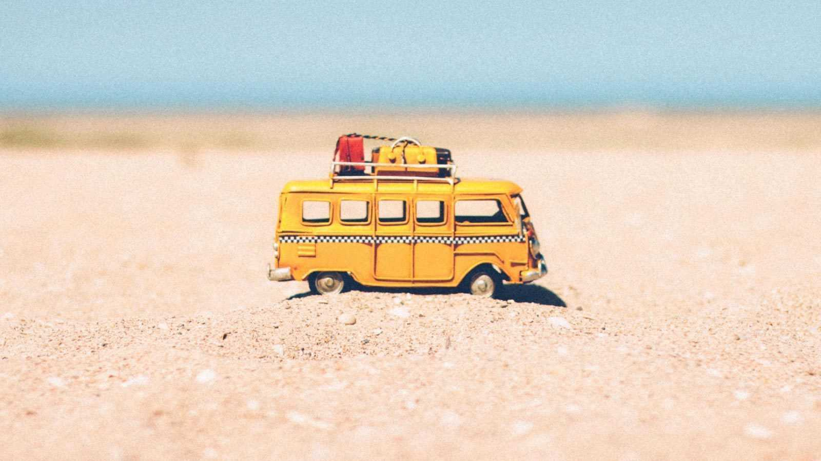 A toy camper van on the beach